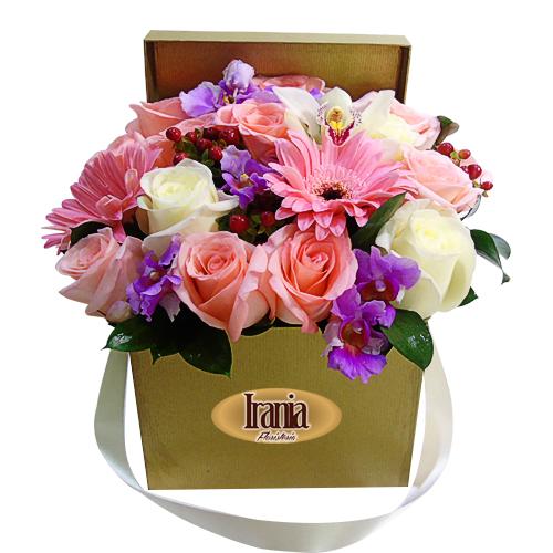 caja cubo con rosas, orquideas y gerberas floristeriabogota.