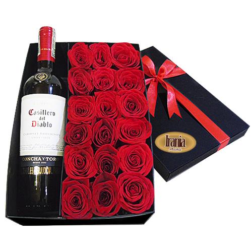 caja de rosas con vino irania floristeria
