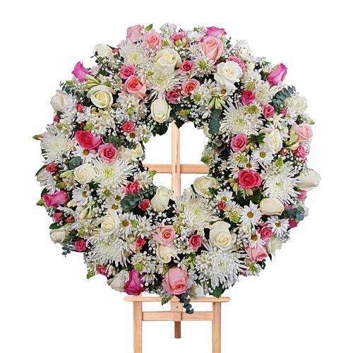 corona en tonos rosados irania floristeria